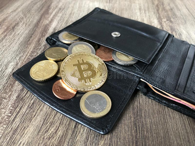 Wallet with bitcoin euro and cent coins. Black leather wallet with bitcoin euro and cent coins, selective focus, cryptocurrency concept stock photos