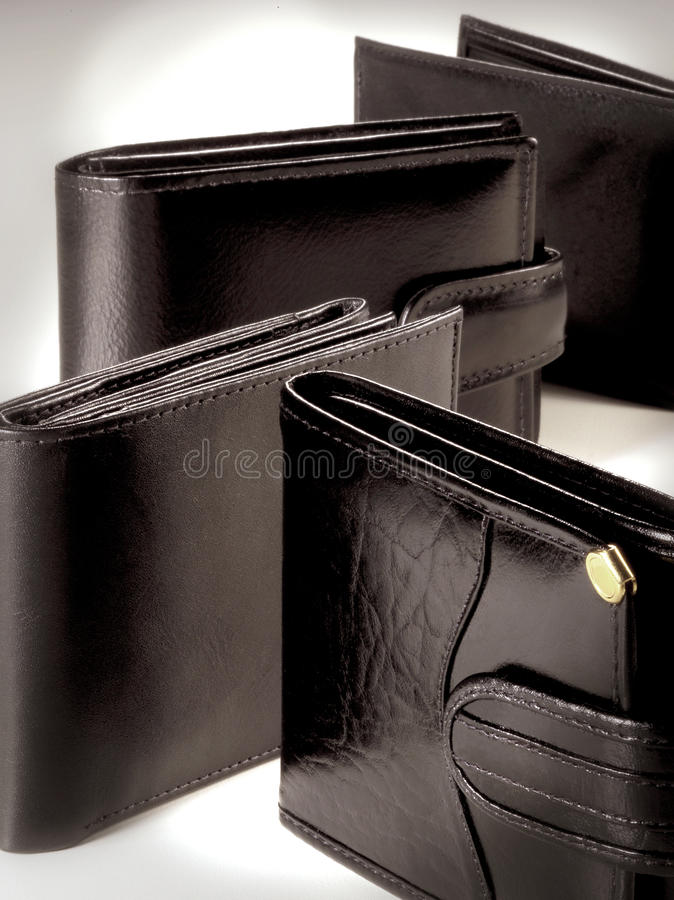 Wallet composition. Composition made by four wallets on degrade background stock photography