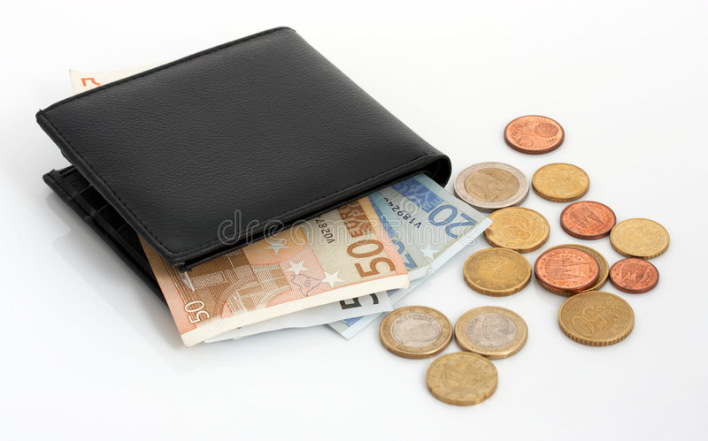 Wallet and currencies. A few euro bills and euro coins royalty free stock photo
