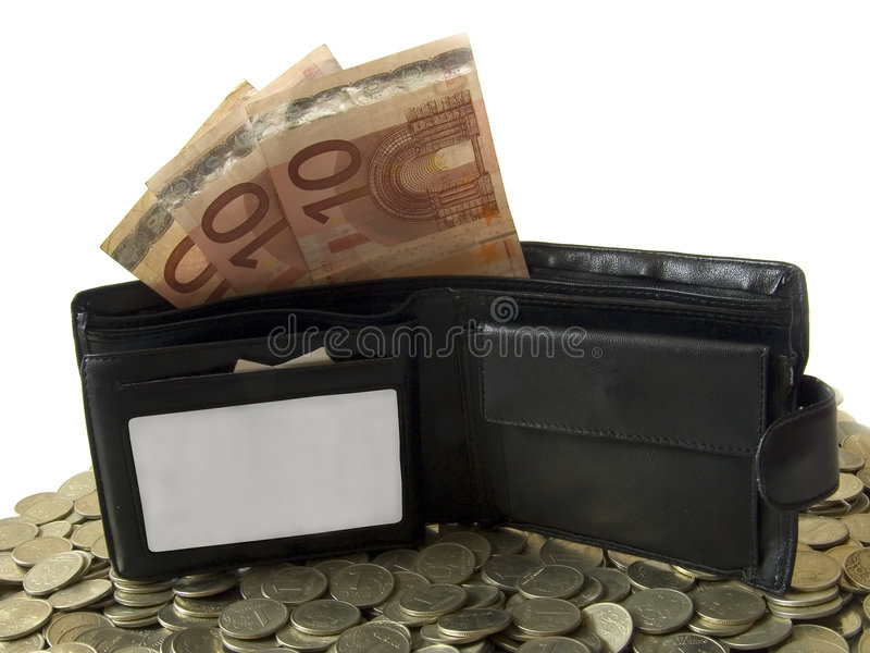 The wallet with euro. The black wallet with euro in it. Laying on the coins. There is a place for the text on the wallet stock photography