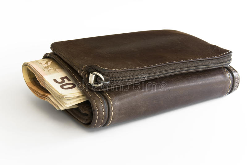 Wallet with Euro Bills. Brown leather Wallet stuffed with Euros stock photos