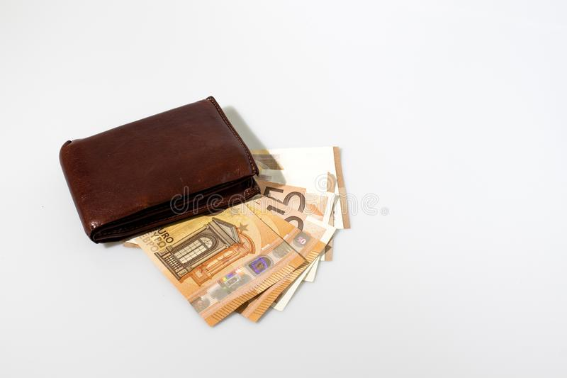 Wallet with money composition in a white background. Composition royalty free stock photos