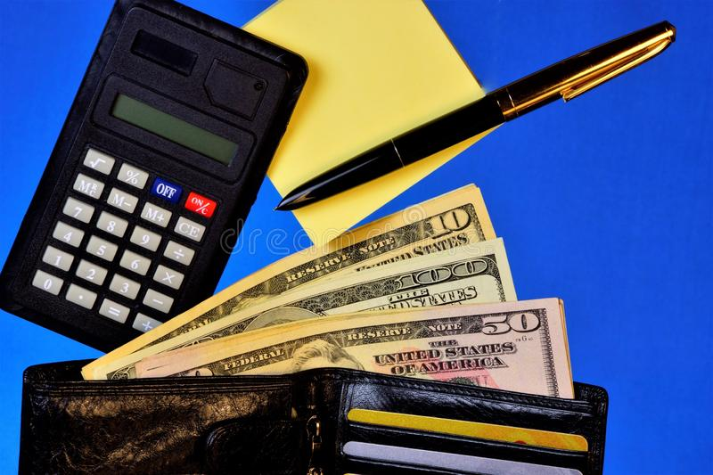 Wallet with money of different banknotes calculator for payments and Bank cards, sticker, pen on blue background of personal stock image