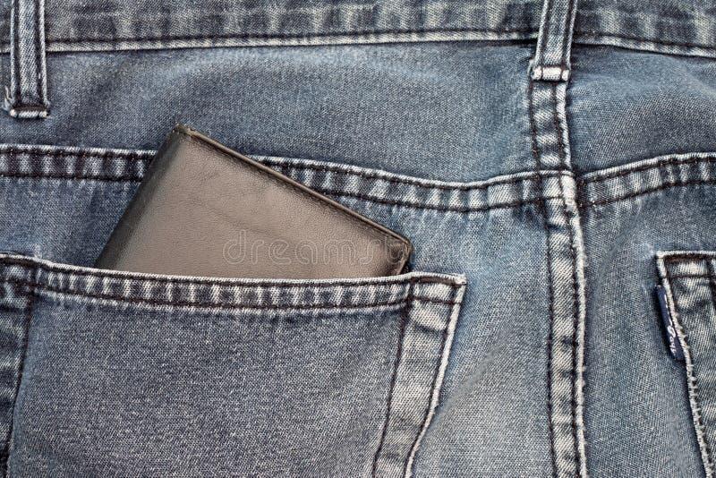 Wallet money inside Jeans stock photos
