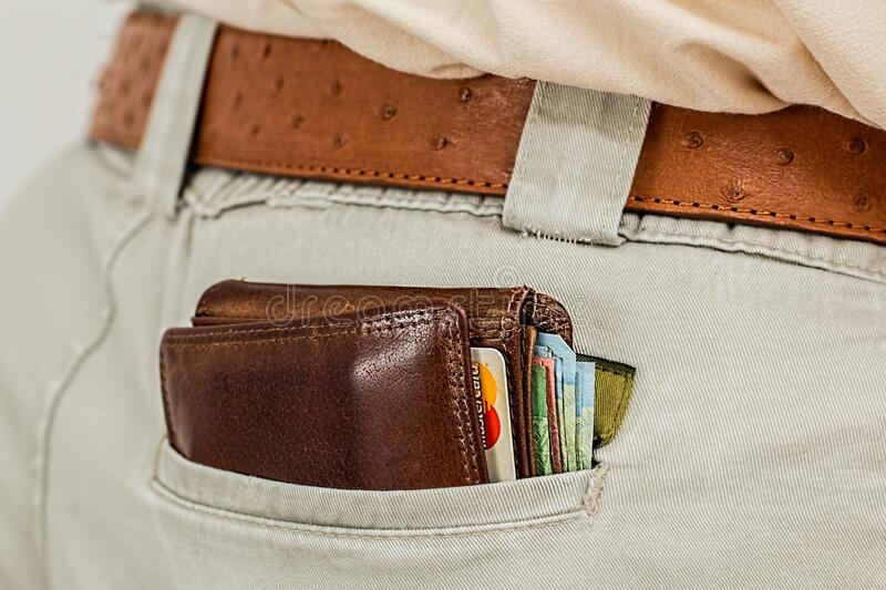 Wallet in pants pocket royalty free stock images
