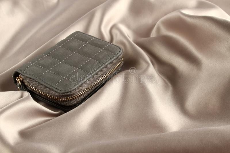 Wallet on silk royalty free stock photos