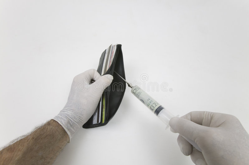 Wallet & Syringe stock photos