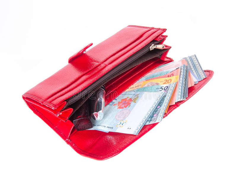 Wallet. woman wallet with money on a background. Wallet. woman wallet with money on background royalty free stock photography