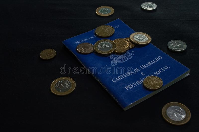 Wallet of work brazilian with coins with the inscripition, minis stock photo