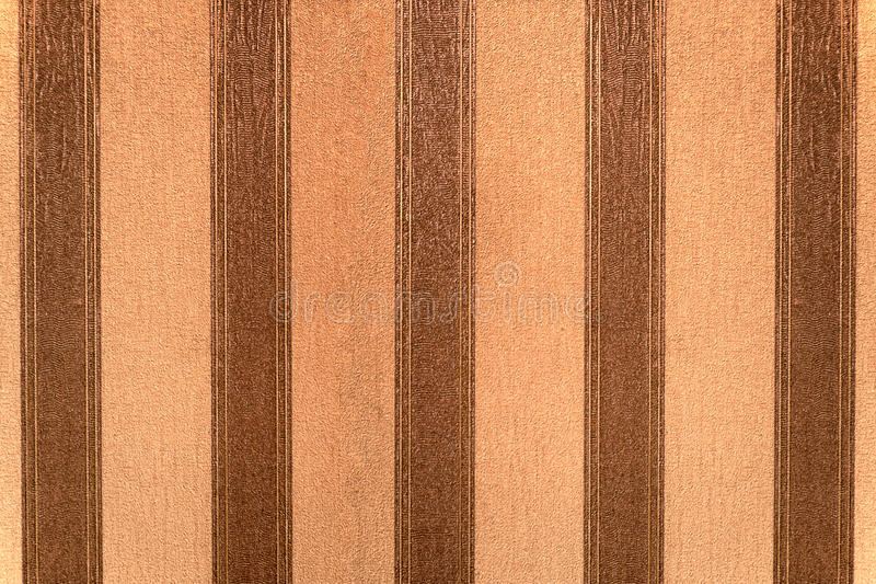 Wallpaper. Old wallpaper with vertical brown and beige stripes royalty free stock photos