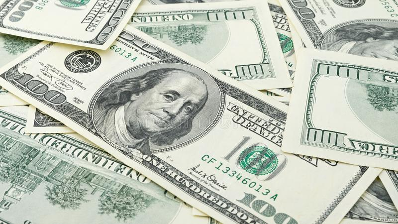 Wallpaper background closeup American money hundred dollar bill. Many US 100 banknote stock images