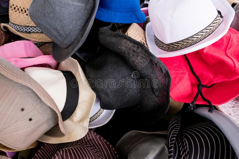 Multiple hat styles at the market. Wallpaper background of colorful hat display basket at a market store. Multiple choice of materials and styles for woman and royalty free stock image