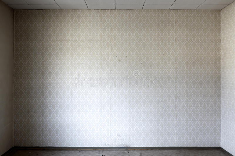 Wallpaper in bare room. Interior of room with old, decorative wallpaper on wall royalty free stock photo