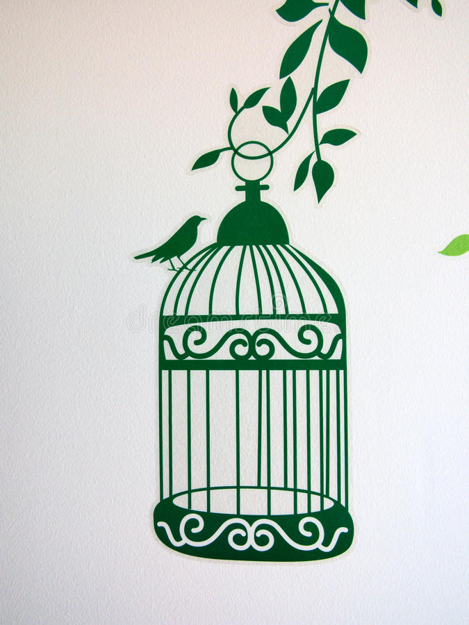 Wallpaper. Bird standing on the top of the cage royalty free stock photos