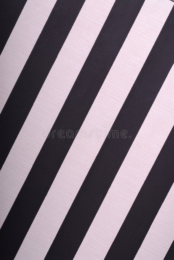 Wallpaper with black and pink slanting lines stock image