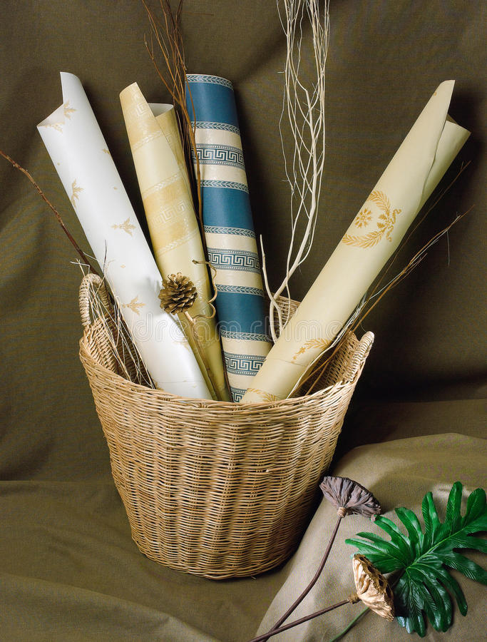 Wallpaper and boarder. Nice wallpaper and boarder display in the rattan basket ready for your wall decoration royalty free stock photography