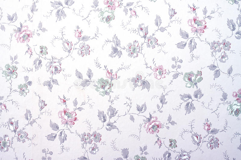 Wallpaper with flowers. A vintage old wallpaper from the fifties, with flowers and buds royalty free stock photo