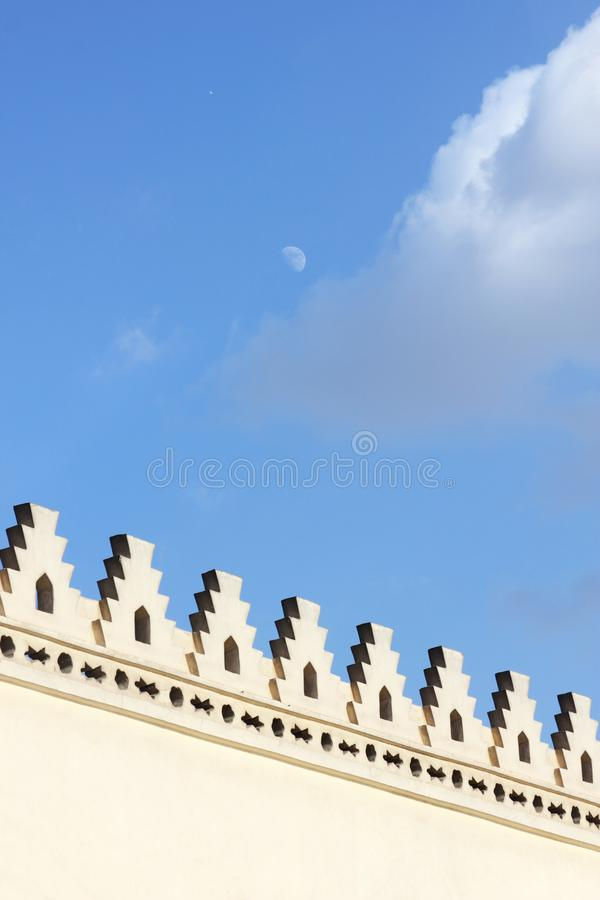 Islamic art with moon wallpaper. Wallpaper of an islamic art of an old vintage mosque located in cairo in egypt and the moon in blue sky background royalty free stock photography