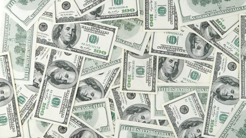 Wallpaper la opinión americana del billete de dólar del dinero ciento del fondo desde arriba Muchos billete de banco de los E.E.U fotografía de archivo