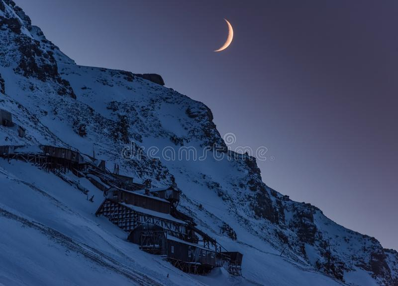 Wallpaper norway landscape nature of the mountains of Spitsbergen Longyearbyen big moon Svalbard polar night with arctic. Winter stock photo
