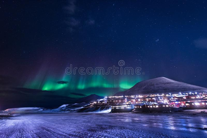 Wallpaper norway landscape nature of the mountains of Spitsbergen Longyearbyen Svalbard building snow city on a polar daynight wit. H arctic winter stock image