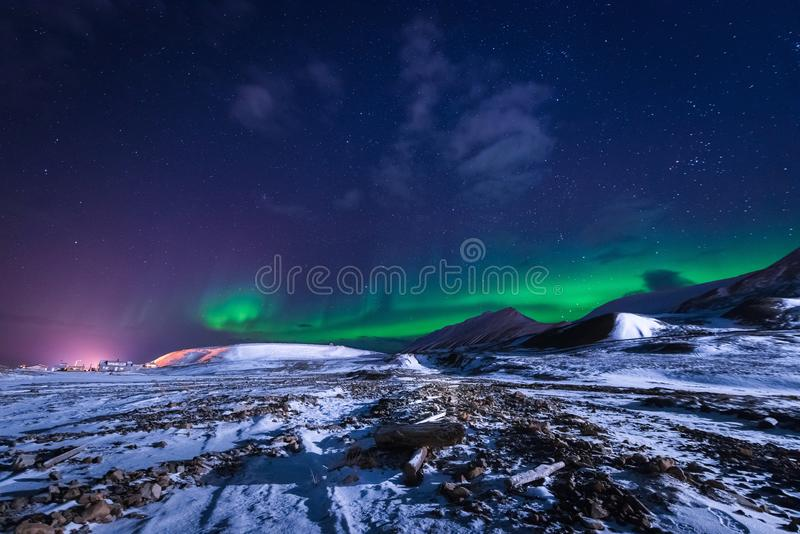 Wallpaper norway landscape nature of the mountains of Spitsbergen Longyearbyen Svalbard building snow city on a polar daynight wit. H arctic winter royalty free stock photos