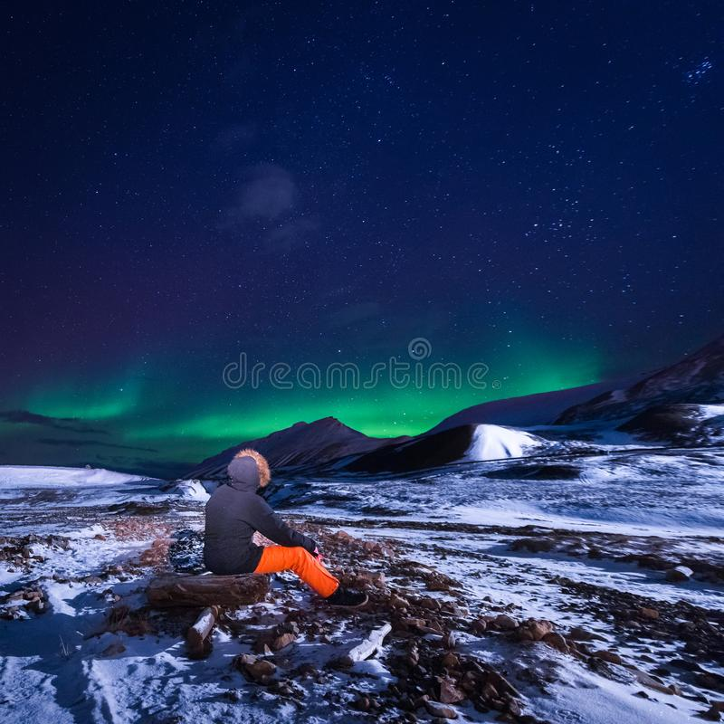 Wallpaper norway landscape nature of the mountains of Spitsbergen Longyearbyen Svalbard building snow city on a polar daynight wit. H arctic winter man stock image