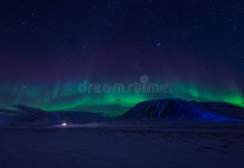 Wallpaper norway landscape nature of the mountains of Spitsbergen Longyearbyen Svalbard building snow city on a polar daynight wit. H arctic winter stock photography