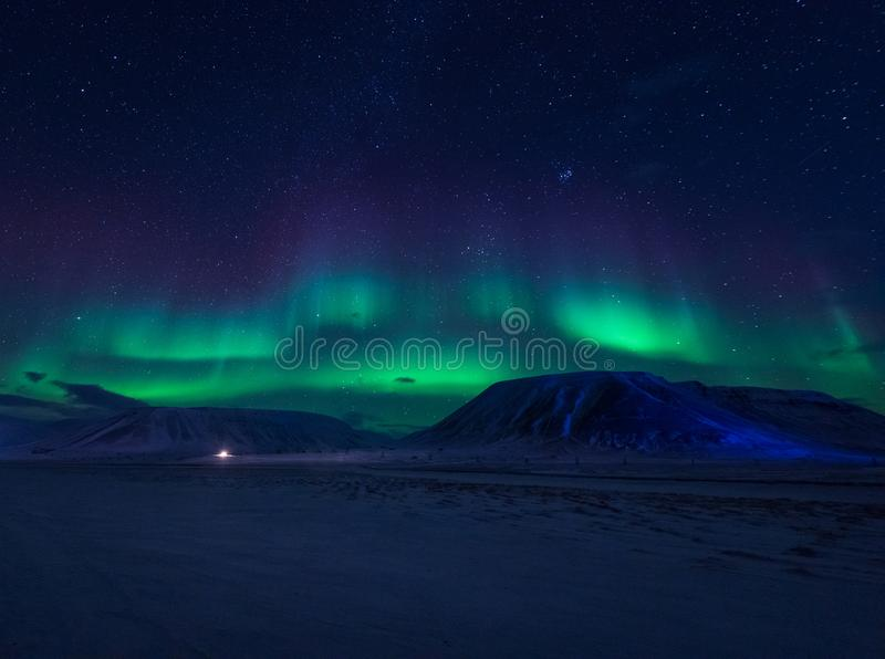Wallpaper norway landscape nature of the mountains of Spitsbergen Longyearbyen Svalbard building snow city on a polar daynight wit. H arctic winter man stock photo
