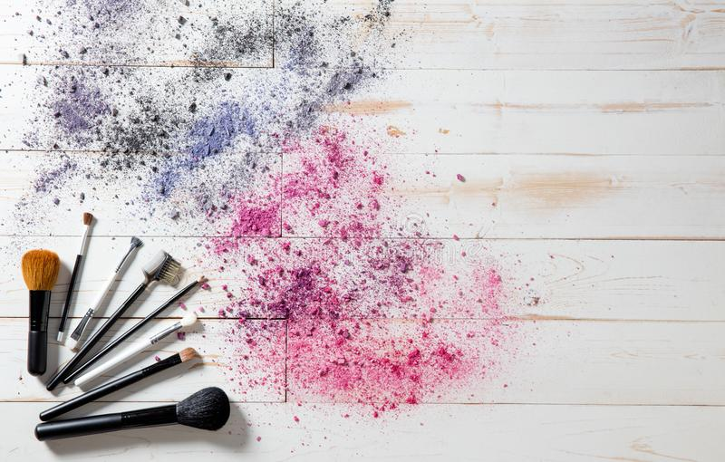 Wallpaper for professional makeup and fashion brushes and colorful pigments stock photography
