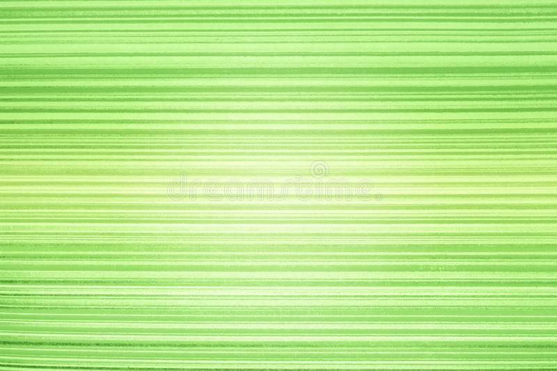 Wallpaper striped. Bright green background in a horizontal band of gold, darkened, vignette.Grunge light green banner texture. Blu. Bright green background in a stock photos