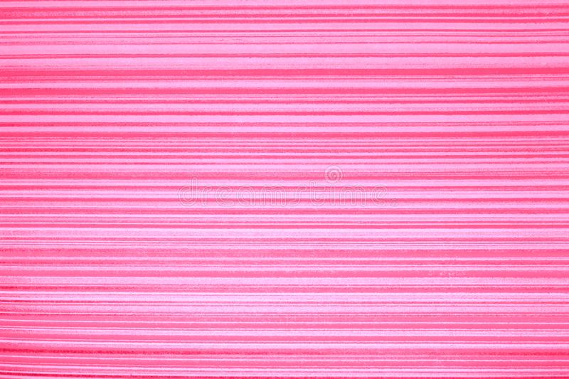 Wallpaper striped. Pink background with a horizontal gold stripe, darkened, vignette.Grunge light pink banner texture. Bright pink horizontal band of gold color royalty free stock photography