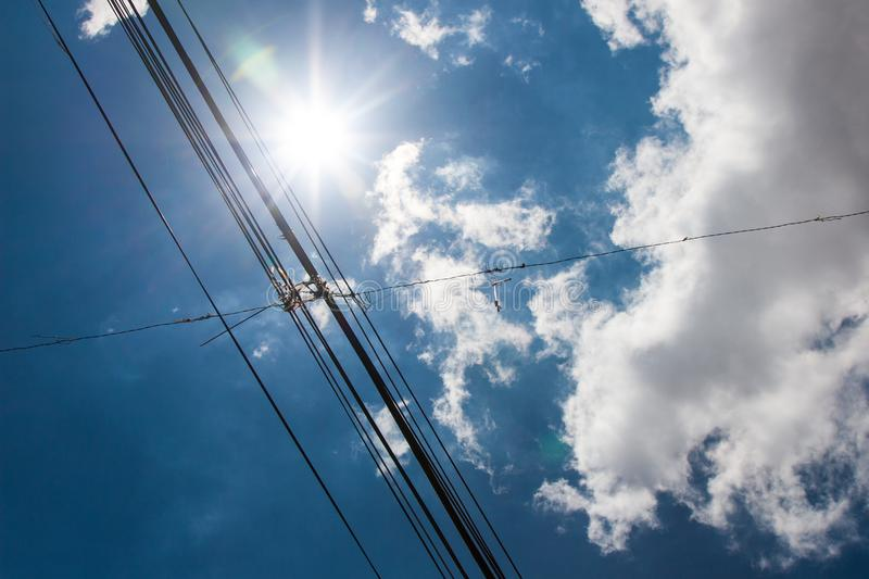 Wallpaper of telecom wires on a sunny day with clouds. royalty free stock photo