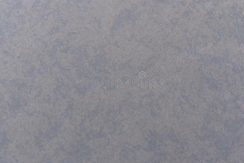 Wallpaper textured chaotic stripes of blue with a gray tint. And white dots stock photo