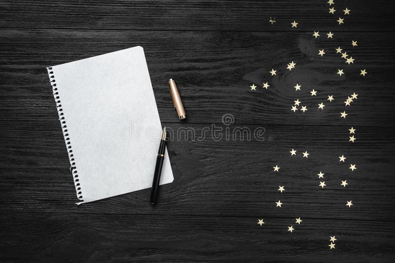 Wallpaper of winter holidays on black background. Letter for Santa Claus. Space for text. Top view.  stock images