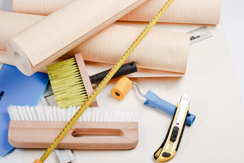wallpapering инструментов стоковое фото rf