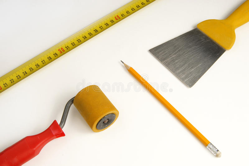 Wallpapering. With a brush and roller royalty free stock photo