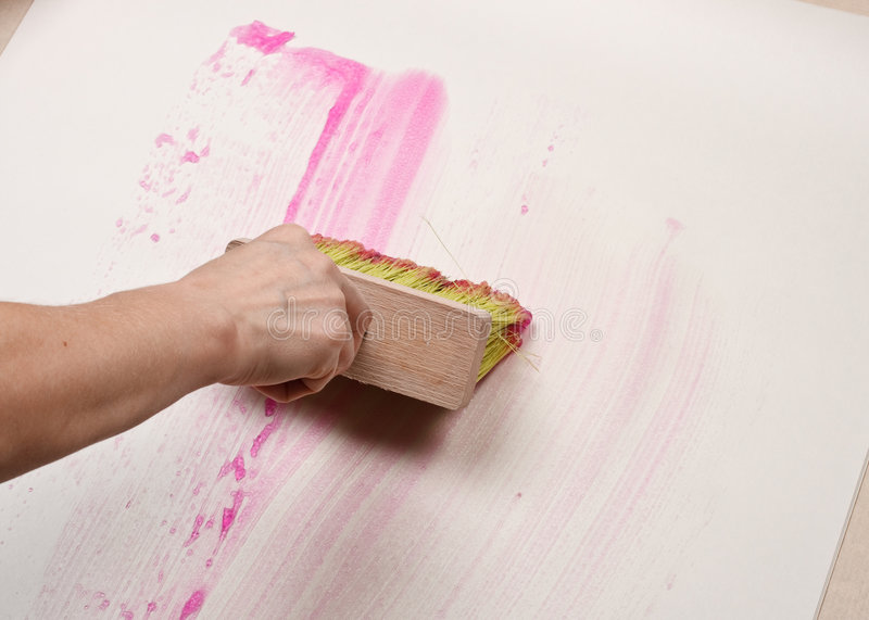 Wallpapering. The hand smearing wall-paper by glue. Home renovation stock photos