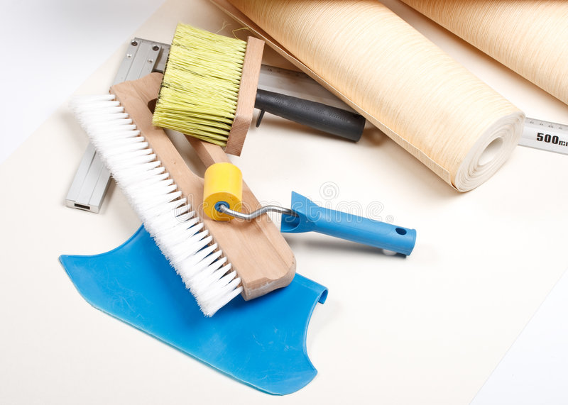 Wallpapering tools. Still-life from various wallpapering tools. Home renovation royalty free stock photography