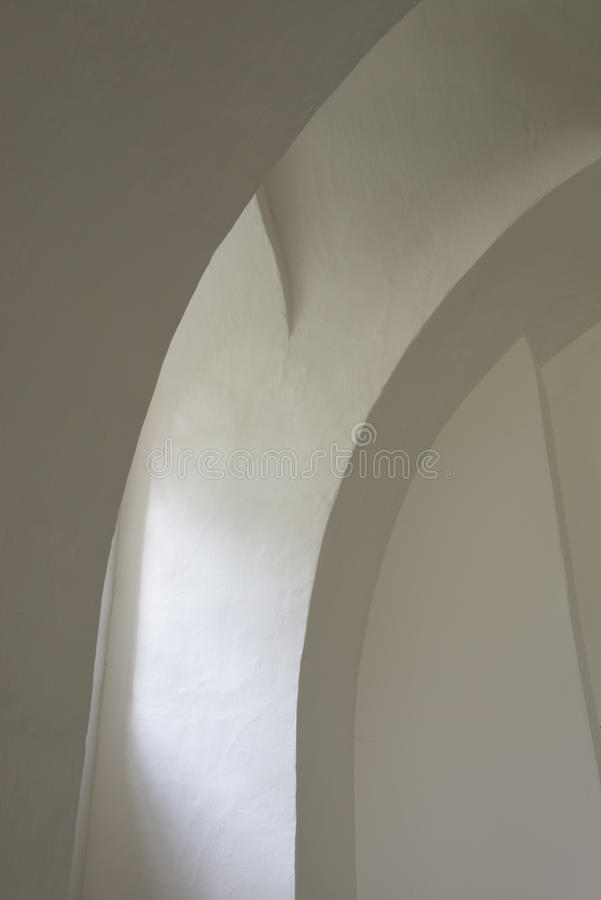 Walls in Church. White curved walls in the church of Oostrum in the province of Groningen stock photography
