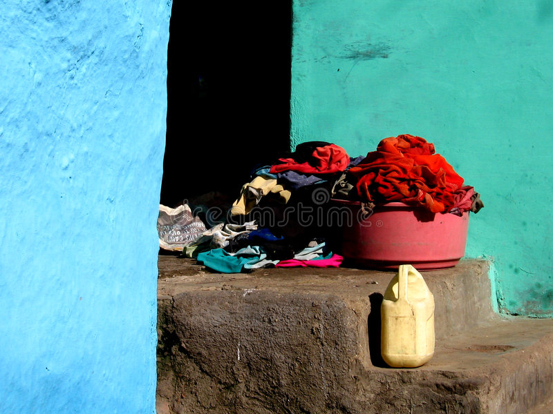 Walls Clothes and Colors. Life is all colorful in the ghetto of India with colorful clothes, buckets and walls stock photos