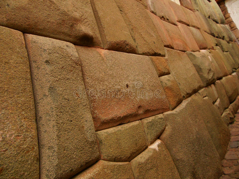 The Walls of Cusco. A detail view of an ancient Inca wall in Cusco, Peru showing tight fitting stonework royalty free stock image