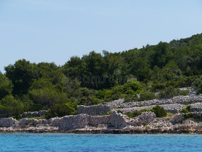 Walls of dry stone on Kakan in the Mediterranean. Drywalls on the island Kakan in the Adriatic sea in Croatia royalty free stock photos