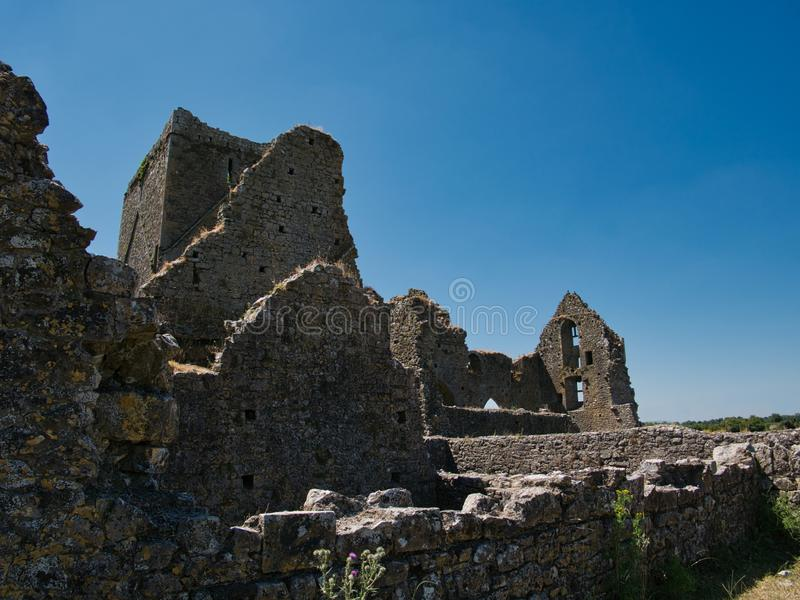 Walls of the Hore Abbey in Cashel before blue sky stock photography