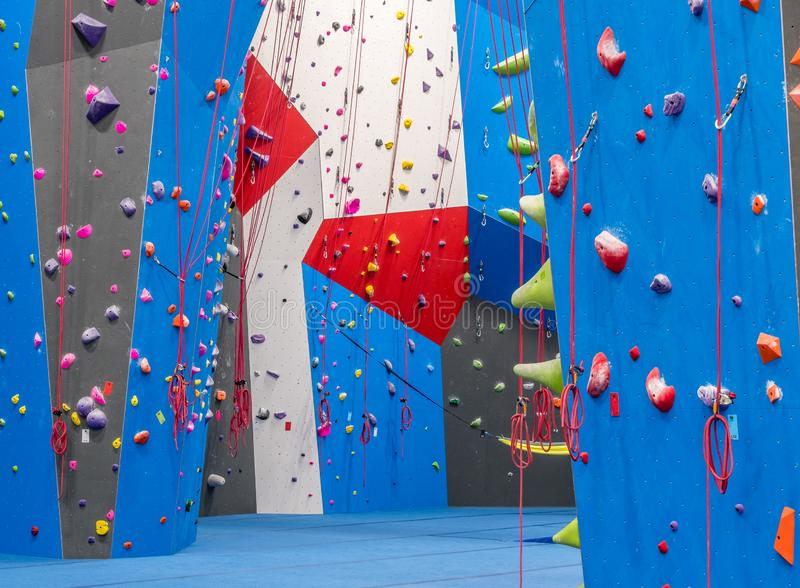 Indoor rock climbing gym. Walls of indoor rock climbing gym royalty free stock photography