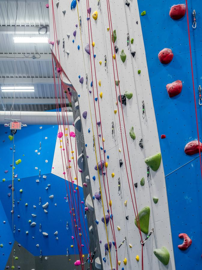 Indoor rock climbing gym. Walls of indoor rock climbing gym royalty free stock photos