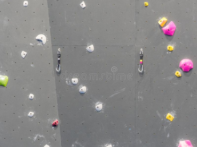 Indoor rock climbing gym. Walls of indoor rock climbing gym stock photos