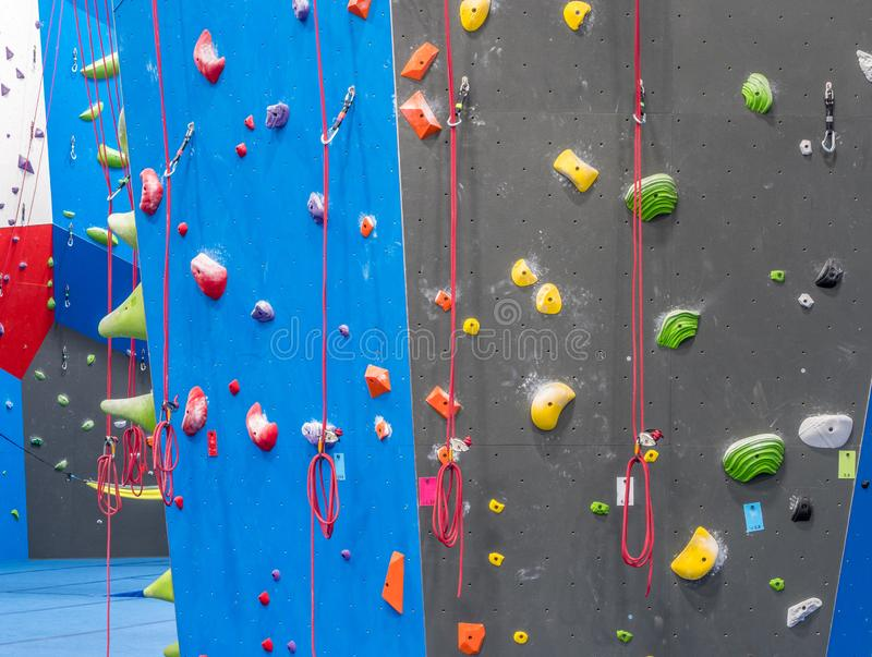 Indoor rock climbing gym. Walls of indoor rock climbing gym royalty free stock photo
