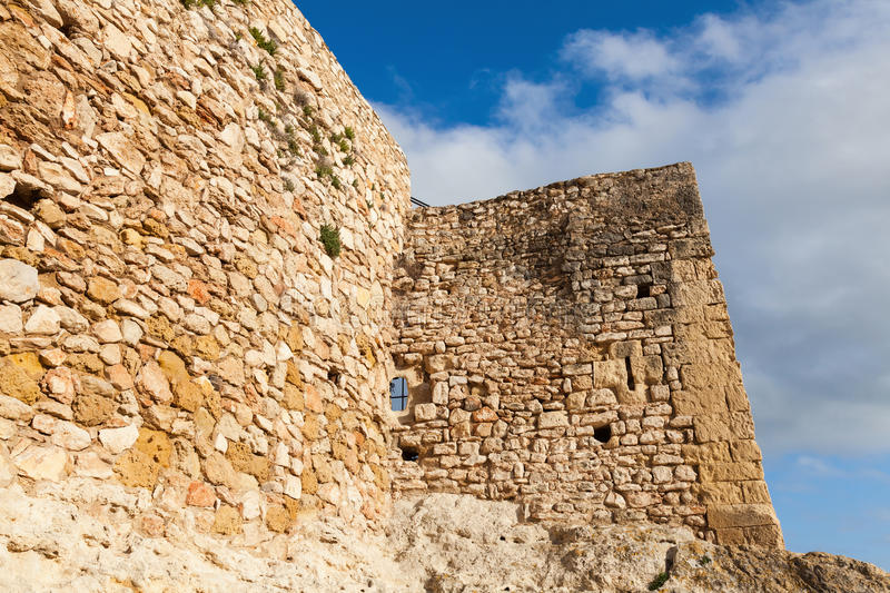 Walls of medieval stone castle. Calafell, Spain. Walls of medieval stone castle. Main landmark of Calafell, Spain stock photo
