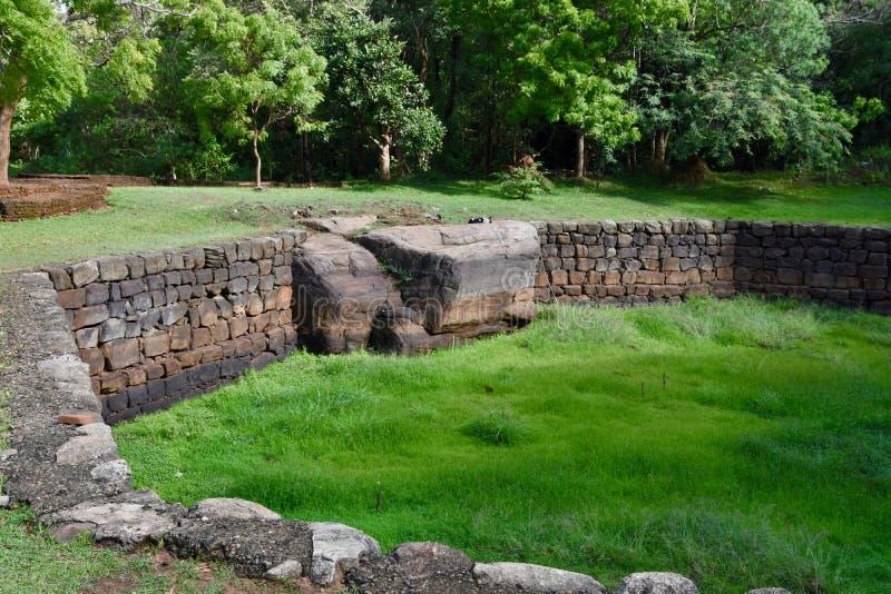 Octagonal pool at Sigyriya. Walls of the octagonal pool at the base of the rock fortress known as Sigiriya in Sri Lanka royalty free stock photos